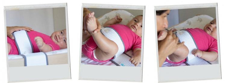 bébé est protégé de la chute grâce à la ceinture à langer